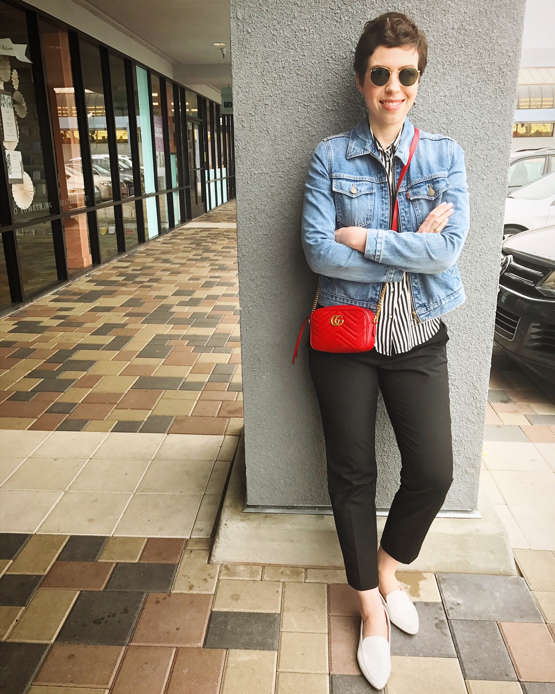 Striped shirt, jean jacket, red Gucci Marmont Matelasse bag